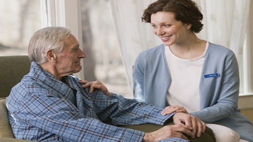Caregiver Helping Elderly Man