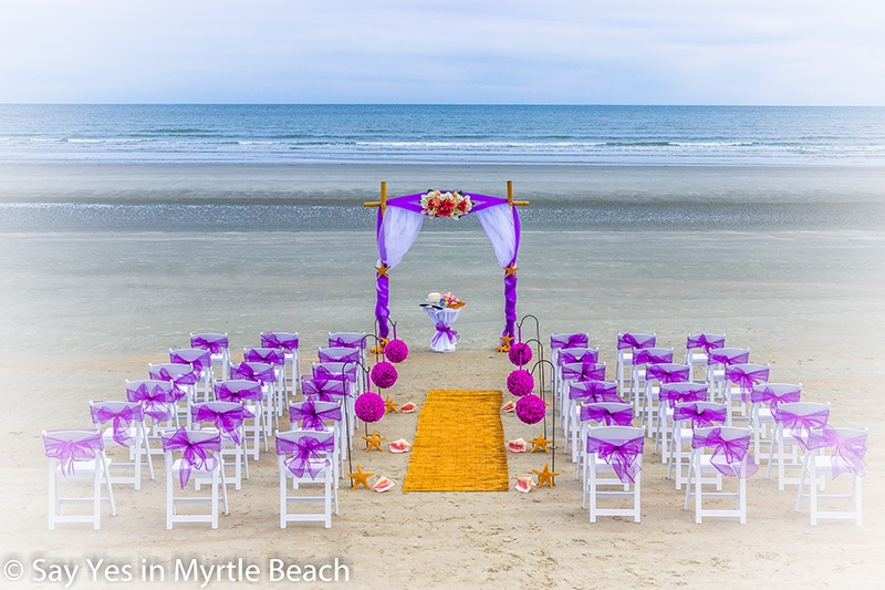 Purple and white tulle wrapped arbor